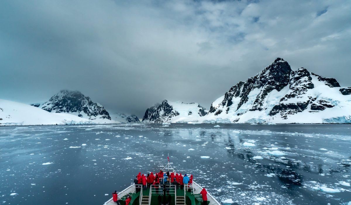 A ship sailing through the ice in Antarctica