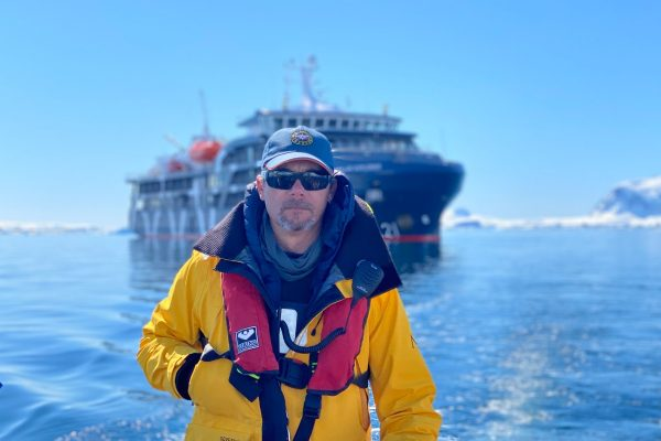 Antarctica expedition guide driving an inflatable dingy