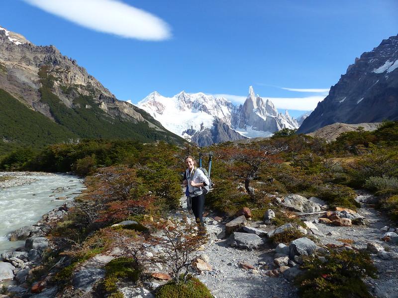 A hiker trekking in mountainous scenery