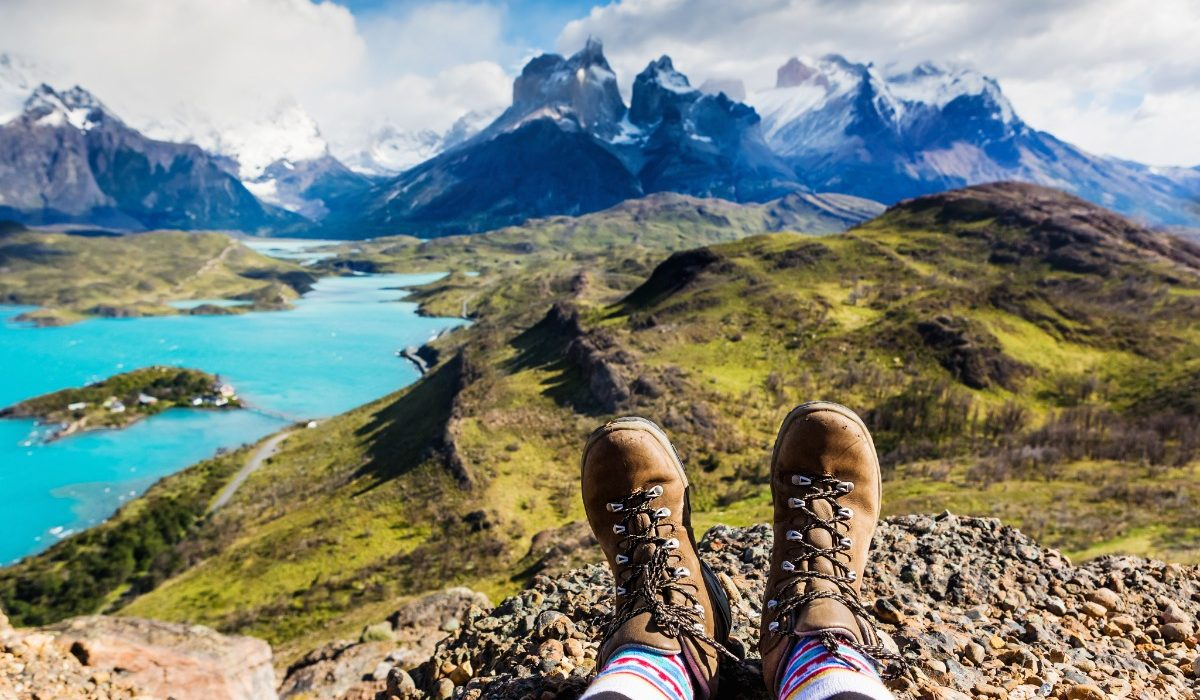 A hiker admires a view of Patagonia's famous horn-shaped mountains