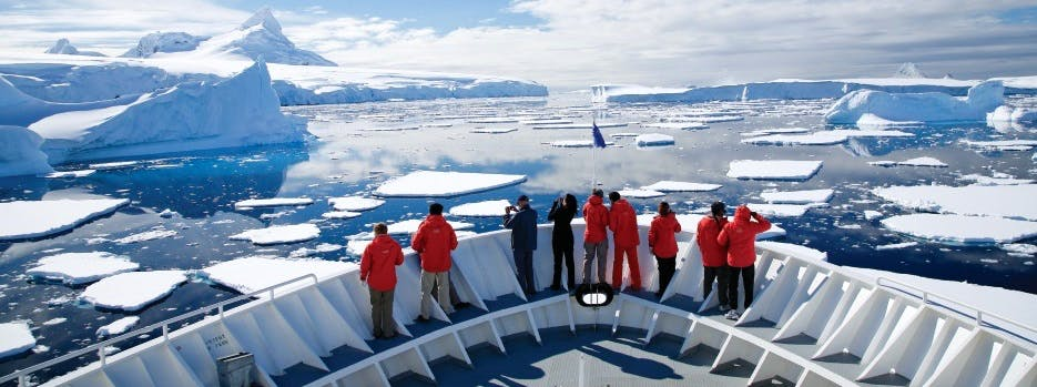 View of icy seas from the bow of an Antarctic expedition ship
