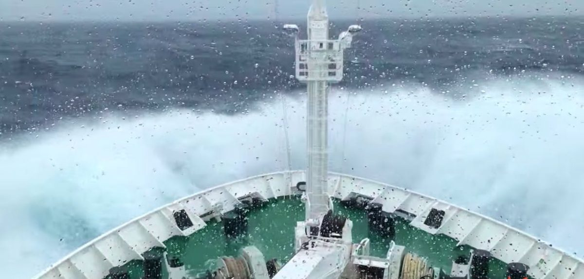A ship sailing across the Drake Passage in rough seas