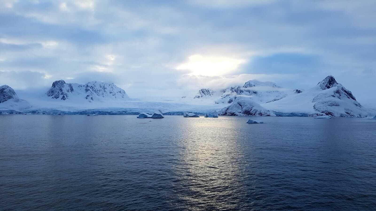 Soft blue light over Antarctic scenery