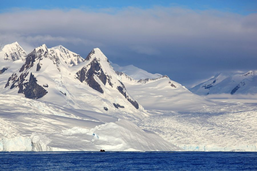 Towering mountains and sweeping glaciers in Antarctica draped in snow