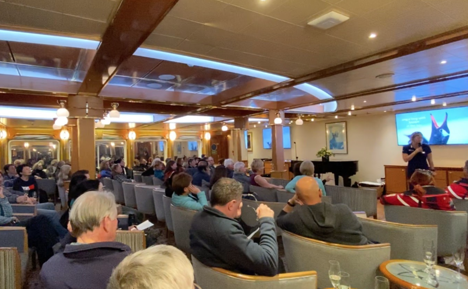 An onboard lecture being given by an Antarctic expedition leader on an Antarctic cruise ship
