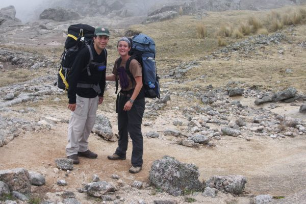 A male and female hiker trekking with large packs