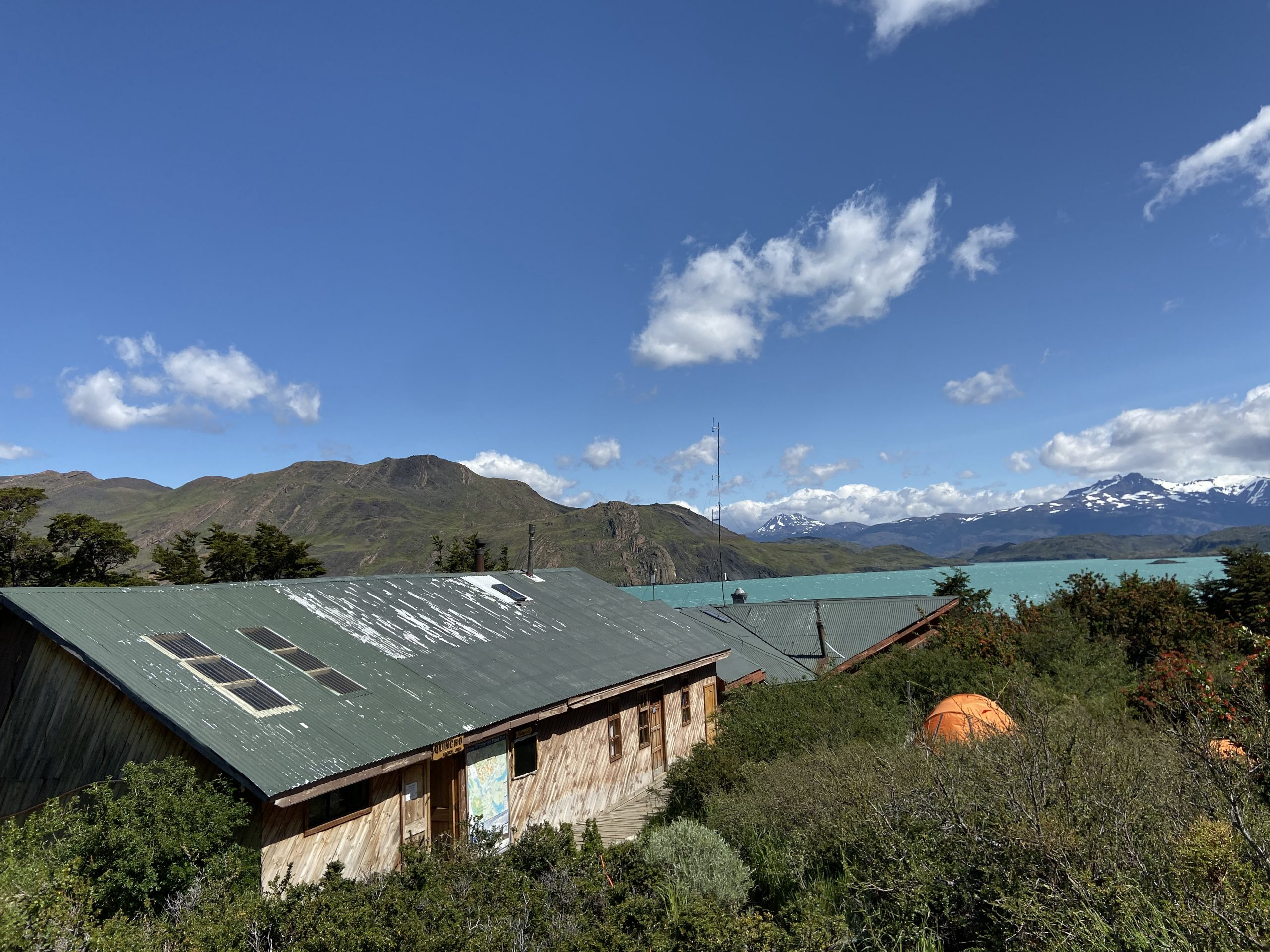 A rustic hiking hostel and views of Refugio Cuernos with views of Lago Nordenskjold