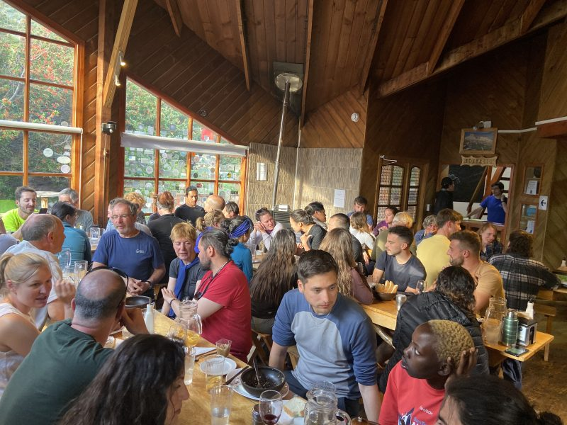 A bustling and sociable dining space at a hiking hostel in Patagonia