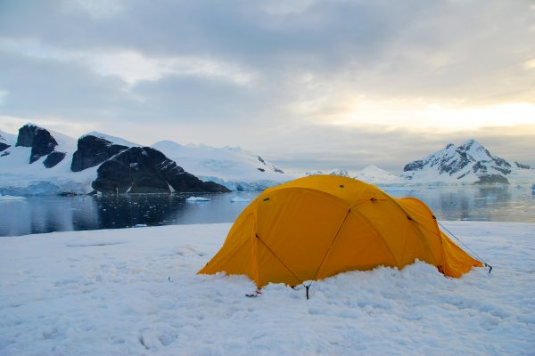 A bright yellow tent pitched in the snow in Antarctica